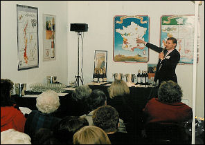 Guy giving a French wine presentation at the Ideal Home  Exhibition in London